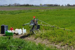 Calibrating small plot sprayer, Germany