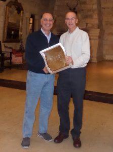 Michael South (left) receiving long service award from Khosro Khodayari